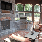 Interior of Screen Porch with Fireplace and Grill