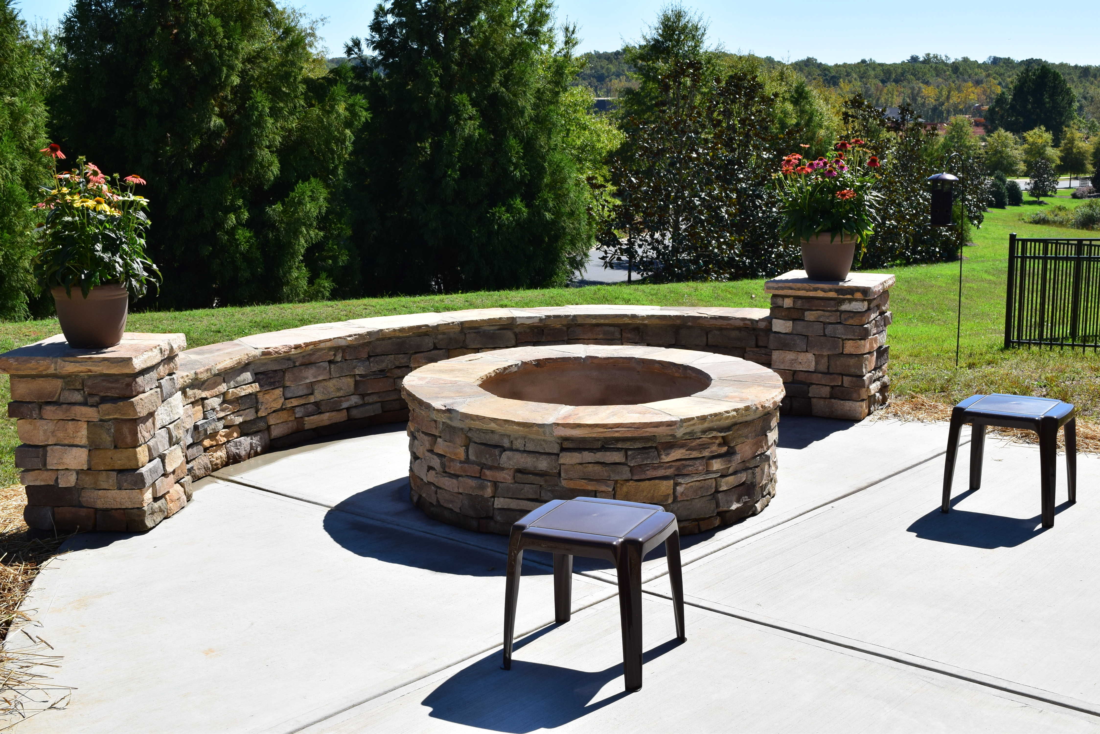 Charlotte Screen Porch Patio With Stone Fire Pit