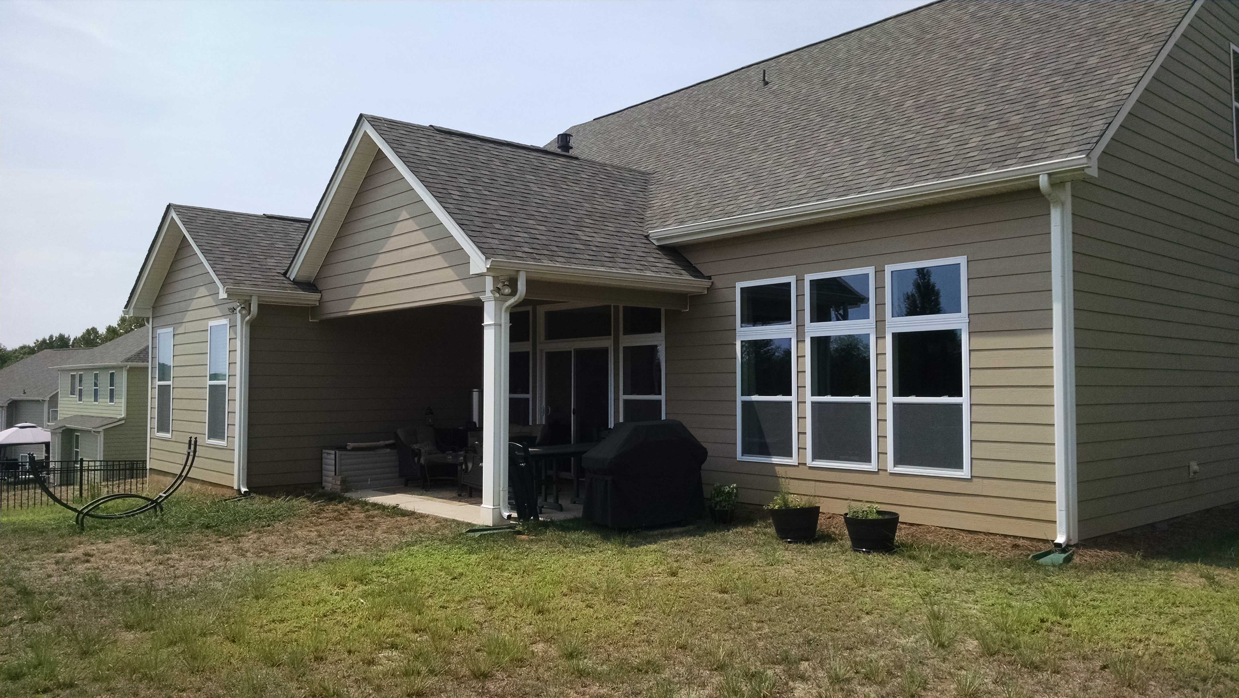 Charlotte Screen Porch & Patio with Stone Fire Pit