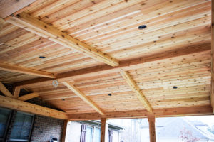 Before fans and stain, cedar covered porch ceiling