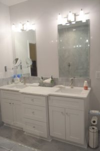 new double vanity with white countertops