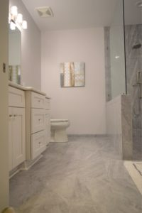 bathroom remodel with new tile floor